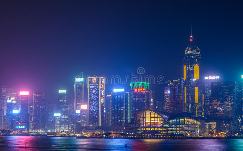 Hong Kong cityscape waterfront over Victoria harbor. HONG KONG, CHINA - DEC 8, 2016: Hong Kong cityscape waterfront over Victoria harbor, to night on December 8 royalty free stock photo