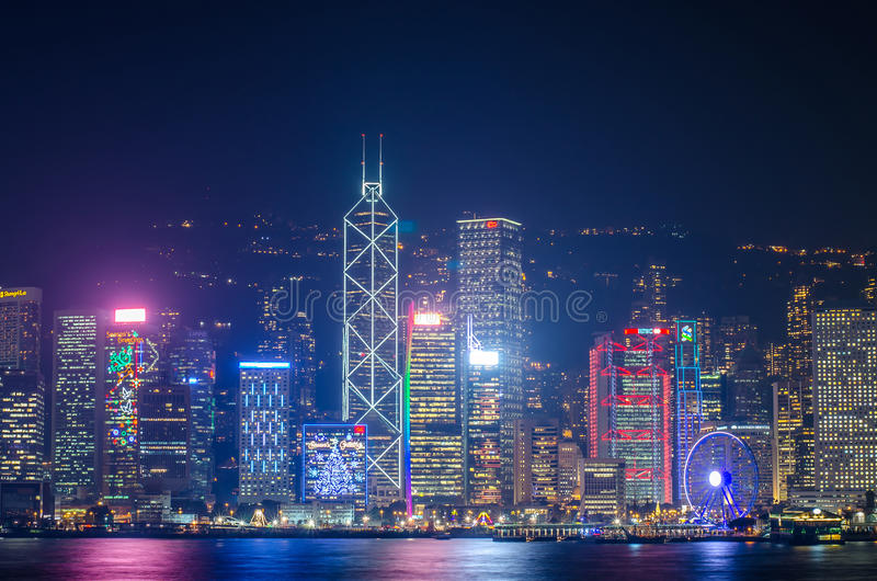 Hong Kong cityscape waterfront over Victoria harbor,. HONG KONG, CHINA - DEC 8, 2016: Hong Kong cityscape waterfront over Victoria harbor, to night on December 8 royalty free stock photo