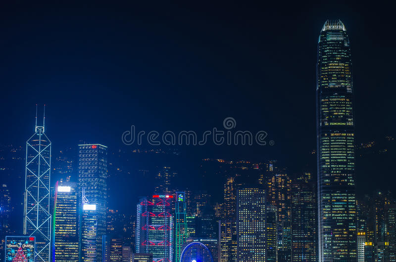 Hong Kong cityscape waterfront over Victoria harbor,. HONG KONG, CHINA - DEC 8, 2016: Hong Kong cityscape waterfront over Victoria harbor, to night on December 8 stock image
