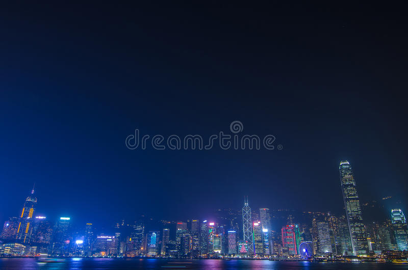 Hong Kong cityscape waterfront over Victoria harbor. HONG KONG, CHINA - DEC 8, 2016: Hong Kong cityscape waterfront over Victoria harbor, to night on December 8 royalty free stock image