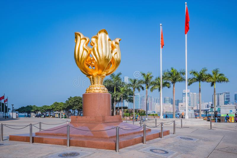 Colden Bauhinia flower statue on Golden Bauhinia Square at sunny day time. Wan Chai district. Hong Kong - December 15, 2016: Colden Bauhinia flower statue on royalty free stock images