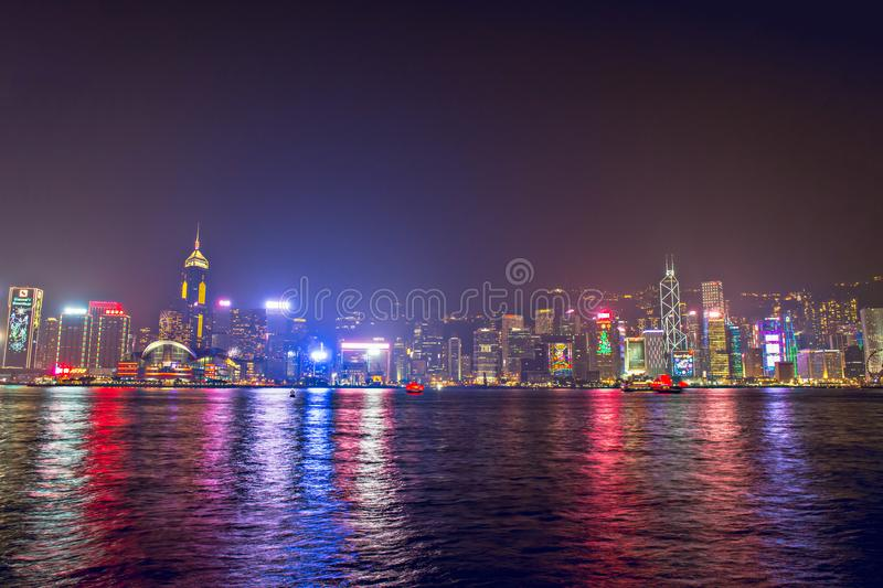 Hong Kong - December 9, 2017. New year and Christmas skyline shines landmark at Victoria harbour night scene with fog in Hong stock photos