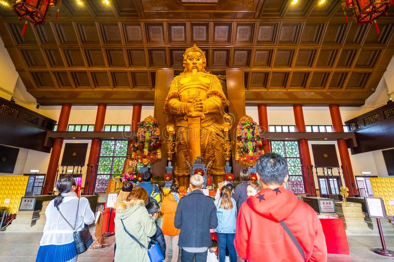 HONG KONG - DECTEMBER 17, 2017 : Pilgrims in the Che Kung taoist temple in Sha Tin, Hongkong. Taoism is a special way of belief pr. Actised mainly in Chinese stock image
