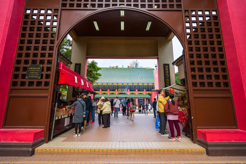 HONG KONG - DECTEMBER 17, 2017 : Pilgrims in the Che Kung taoist temple in Sha Tin, Hongkong. Taoism is a special way of belief pr. Actised mainly in Chinese stock photography