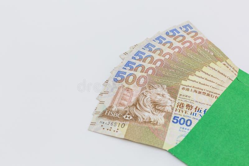 Hong Kong dolara banknotów pieniądze w zielonej kopercie na białym tle, Pięćset Hong kong dolarów obraz royalty free