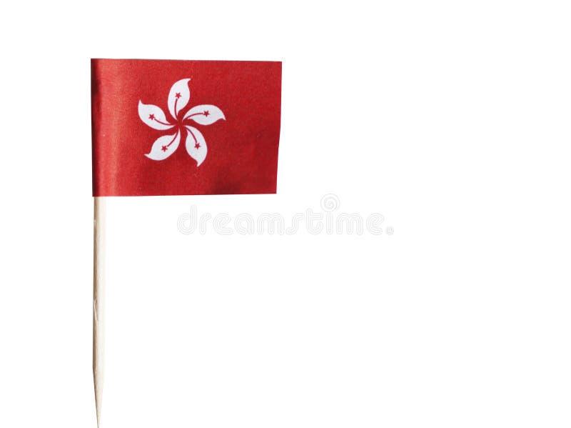 Hong Kong-Flagge im Zahnstocher gegen weißen Hintergrund lizenzfreie stockfotos