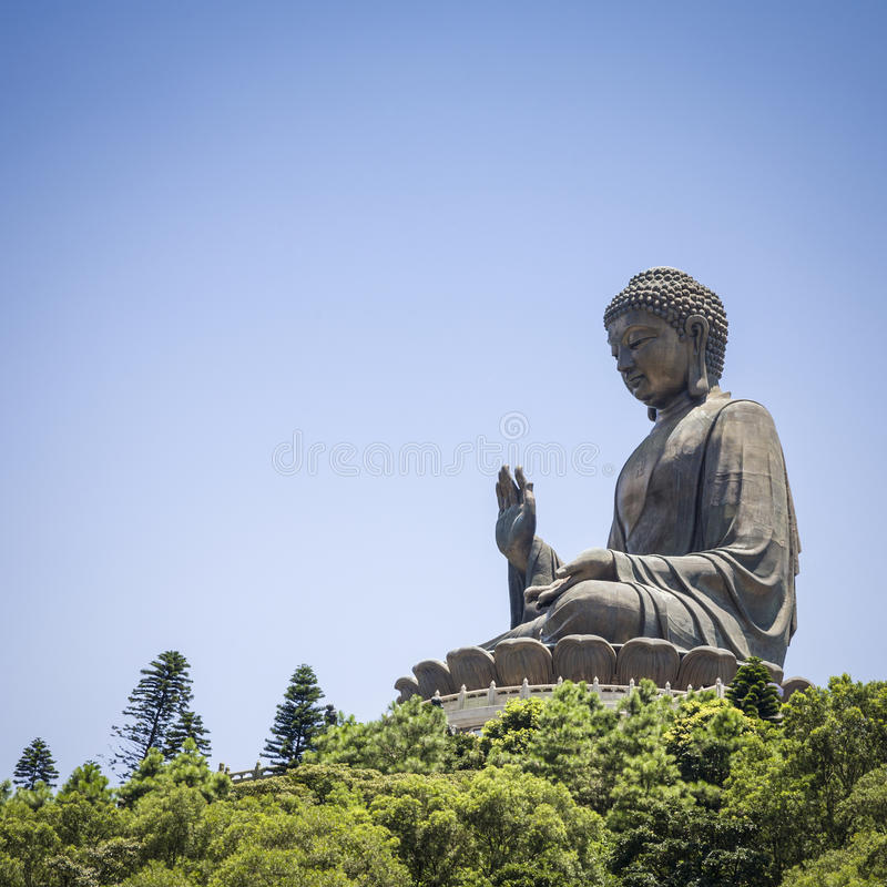 Hong Kong The Giant Buddha. Giant statue of Buddha on Lantau Island, Hong Kong, known as the Tian Tan Buddha, reached by 25 minute cable car ride royalty free stock photography