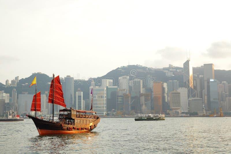 Hong Kong harbor. With red sail boat royalty free stock images