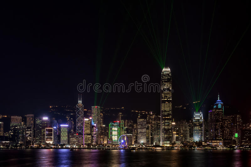 Hong Kong Harbor Bathed in Lasers. Hong Kong Harbor during the Symphony of Lights laser show in the evening stock images
