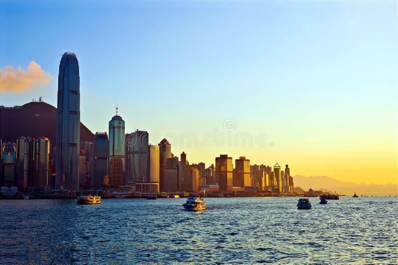 Hong Kong harbor evening view. Beautiful view of skyscrapers of hong kong at victoria harbor during sunset stock image