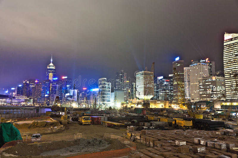 Hong Kong Harbor Laser Show. VICTORIA, HONGKONG - JANUARY 07: view during Hong Kong Harbor Laser Show to Skyline of Victoria and a construction site by night on royalty free stock image