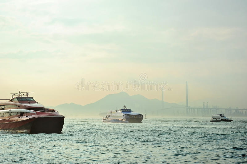 Hong Kong harbor. Macao to Hong Kong ferry boats in Hong Kong harbor. Tsing-Ma Bridge on the background royalty free stock photos