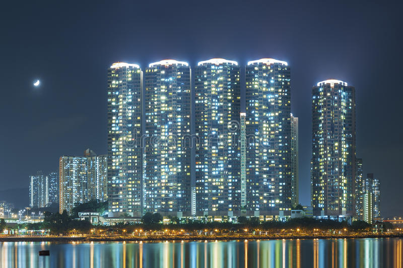 Hong Kong Harbor at night. High rise residential buildings in Hong Kong City at night royalty free stock photos