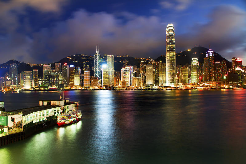 Hong Kong Harbor at Night from Kowloon Ferry. Hong Kong Harbor at Night from Kowloon Star Ferry Reflection May 5, 2011 royalty free stock photo