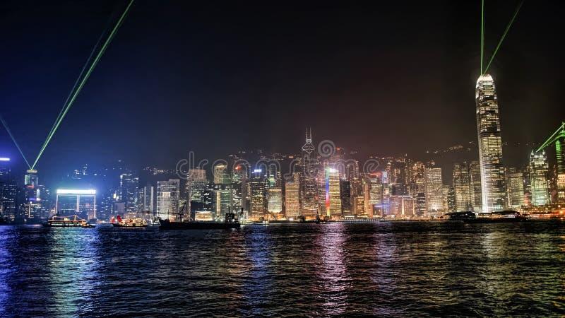 Hong Kong harbor and night skyline. And ship stock photo