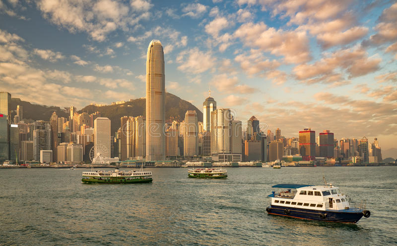 Hong Kong harbor at sunrise. Busy Hong Kong harbor in the glow of sunrise royalty free stock photography