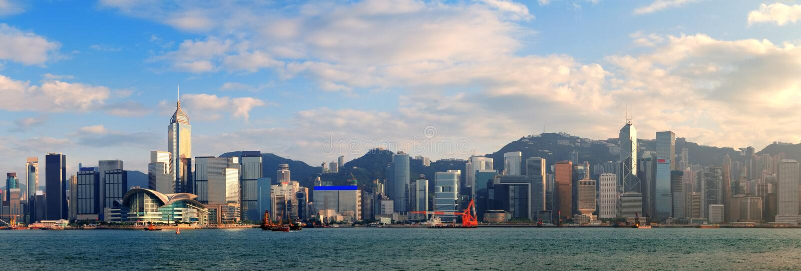 Hong Kong Harbor. Hong Kong Victoria Harbor in afternoon with urban city skyline and colorful cloud stock photo
