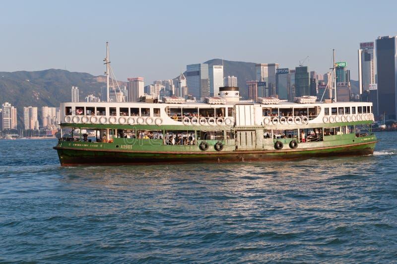 Hong Kong harbor view. Hong kong - October 21, 2012:Hong Kong Skyline in the afternoon view of spectacular victoria harbor of hong kong with passenger ferry stock image