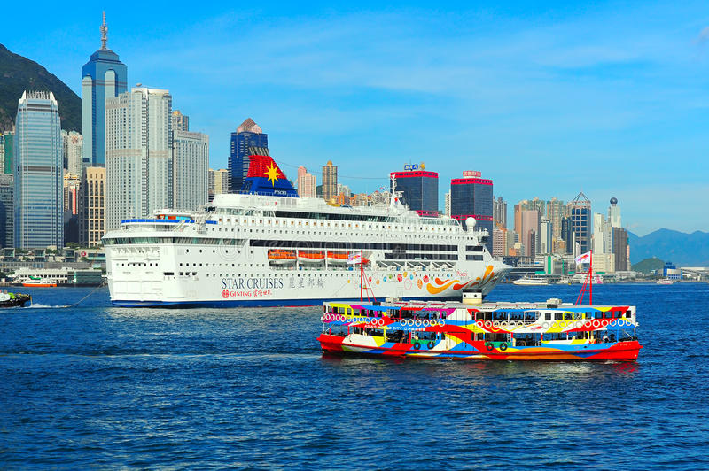 Hong Kong harbor view. View of beautiful victoria harbor of hong kong with a luxury cruise boat and star ferry passenger boat royalty free stock photography