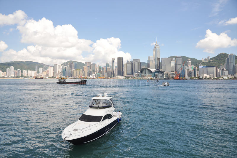 Hong Kong harbour. By Victoria Bay,yacht in the blue sea royalty free stock images