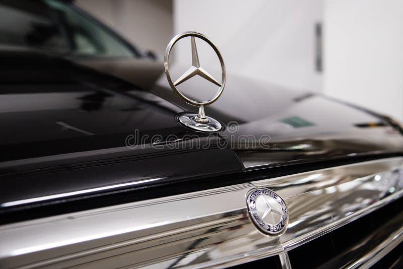 Hong Kong, Hong Kong - 25 April 2018: Close-up of Mercedes Benz logo badge and car grill on black Mercedes Benz sedan. stock images