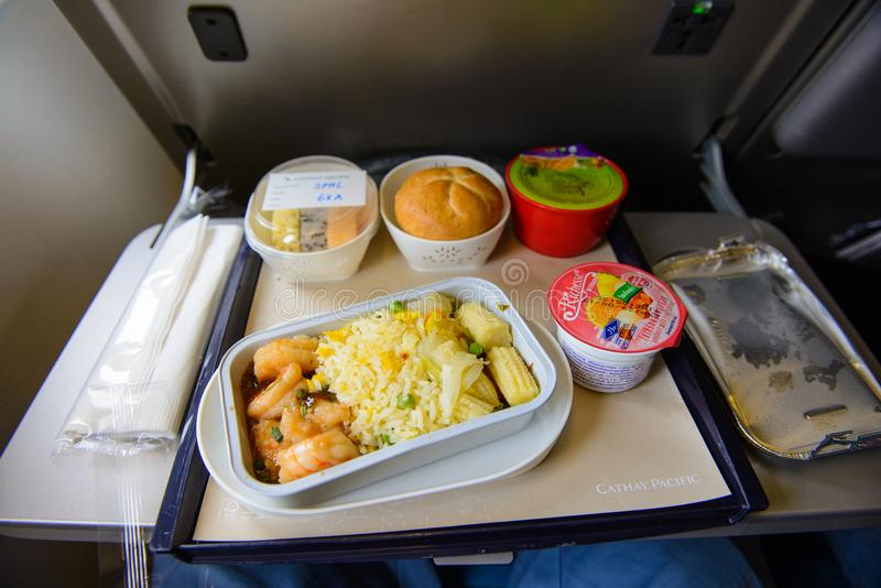 Hong Kong, Hong Kong - August 8, 2015 : Cathay Pacific food served on board of economy class airplane on the table royalty free stock photos