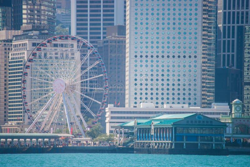 Hong Kong - January 10, 2018 :View of Cityscape at Victoria Harbor Island, Hong Kong. Landmark royalty free stock image