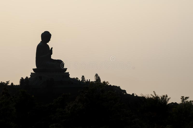 Silhouette of Hong Kong`s famous Big Buddha at Ngong Ping, Lantau Island. HONG KONG - MARCH 23, 2014 - Silhouette of Hong Kong`s famous Big Buddha at Ngong Ping stock photography