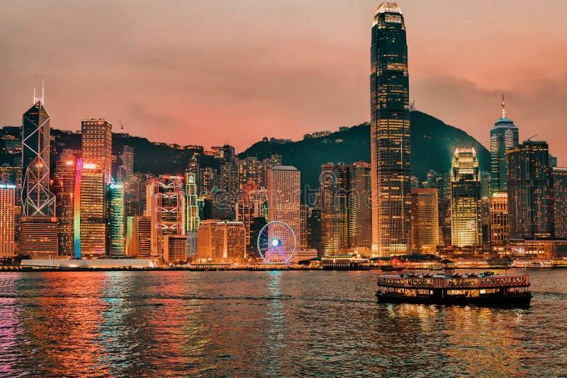 Skyline in Victoria Harbor, in Hong Kong. View from Kowloon on HK Island. Hong Kong, Hong Kong - March 6, 2016: Skyline in Victoria Harbor, in Hong Kong. View royalty free stock photo
