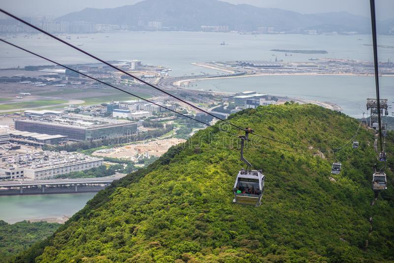 HONG KONG NGONG PING July 26 th 2018 : Long distance cable car across the mountain in Hongkong, Ngong Ping cable car.  stock photography