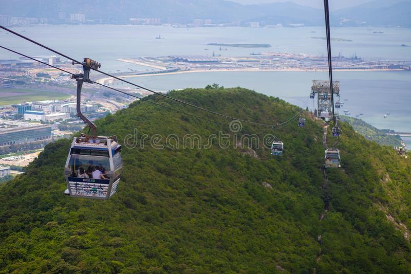 HONG KONG NGONG PING July 26 th 2018 : Long distance cable car a. Cross the mountain in Hongkong, Ngong Ping cable car royalty free stock photography