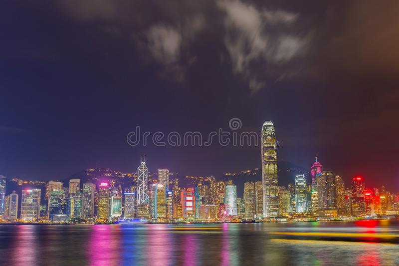 Hong Kong at night from across Victoria Harbor. Modern landmark royalty free stock image