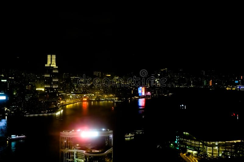 Hong Kong at night with advertising, chinese ideographs stock image