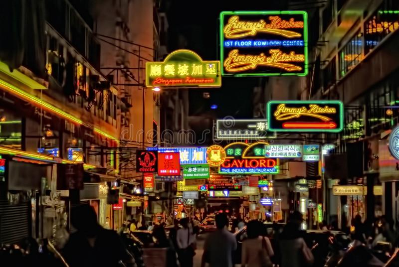 Hong Kong Night Scene. Downtown Hong Kong at night is a riot of sights and sounds, not the least of which is the jumble of store signs, as captured in this image royalty free stock photos