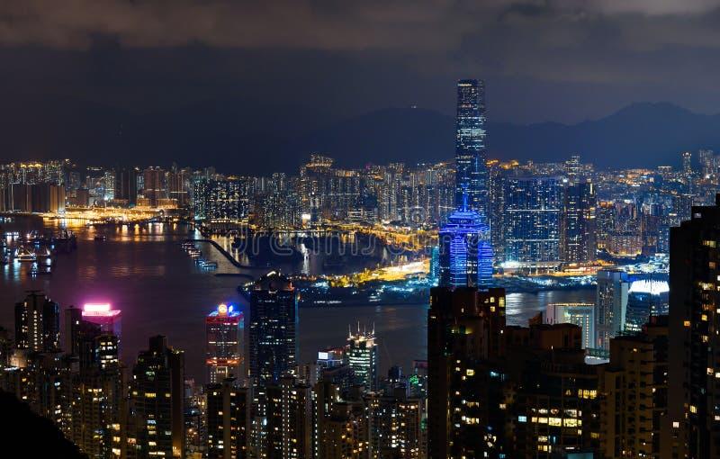 Hong Kong night skyline modern cityscape view from the Victoria peak. Hong Kong night skyline illuminated modern cityscape view from the Victoria peak, harbor royalty free stock images