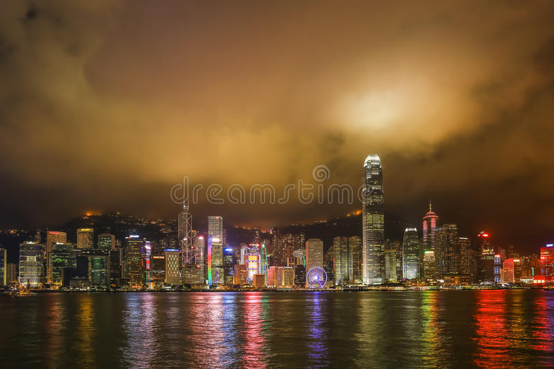 Hong Kong night view at Victoria harbor. Hong Kong night view with reflections of light on the cloud at victoria harbor stock photos