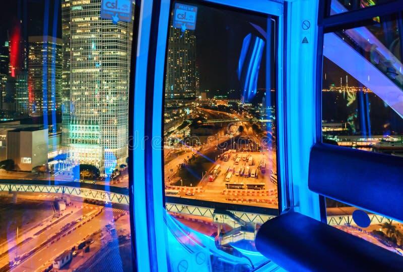 Hong Kong Observation Wheel tem 60 medidores de altura O maior parte do distrito central é visto de suas cabines foto de stock royalty free