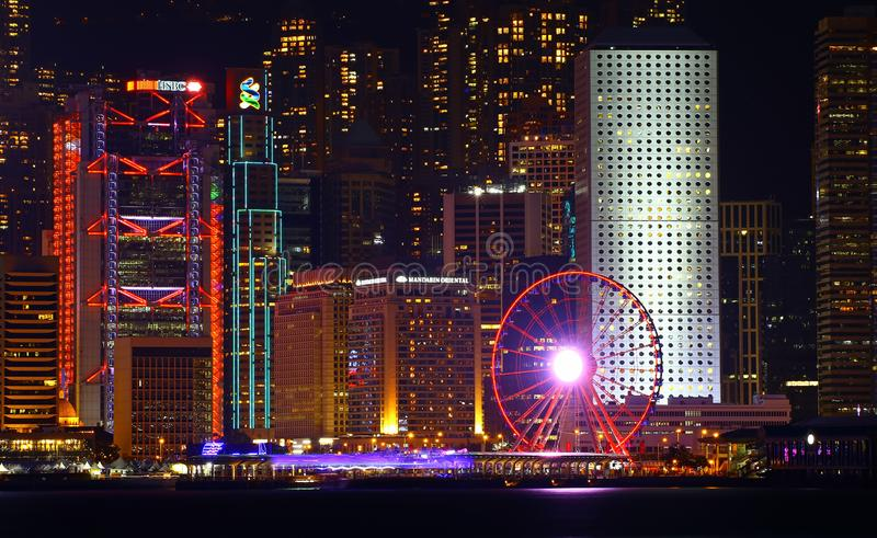 The hong kong observation wheel. Victoria harbor night view with the hong kong observation wheel. 60 meters high hong kong observation wheel is the one of the royalty free stock photos