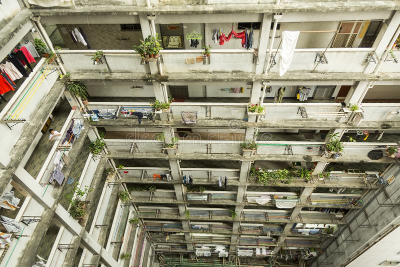 Hong Kong housing. Hong Kong is one of the most densely populated places in the world. Hong Kong has a population density of 6,300 people per square km. As the royalty free stock images
