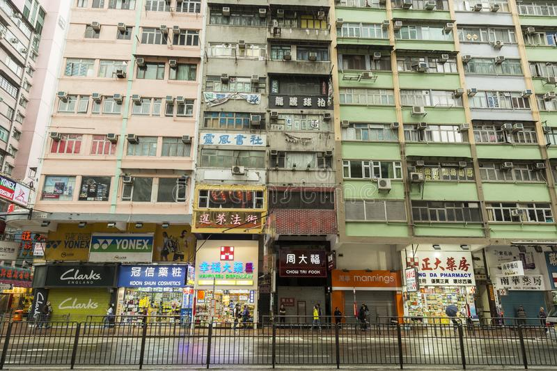 Hong Kong housing. Hong Kong is one of the most densely populated places in the world. Hong Kong has a population density of 6,300 people per square km. As the stock image