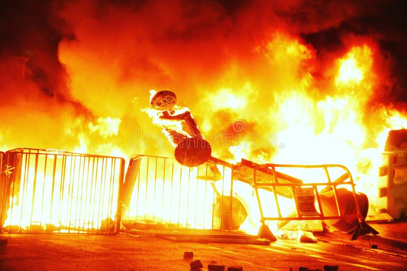 Hong Kong protesters set fire to block streets stock photography