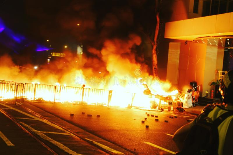 Hong Kong protesters set fire to block streets stock photo