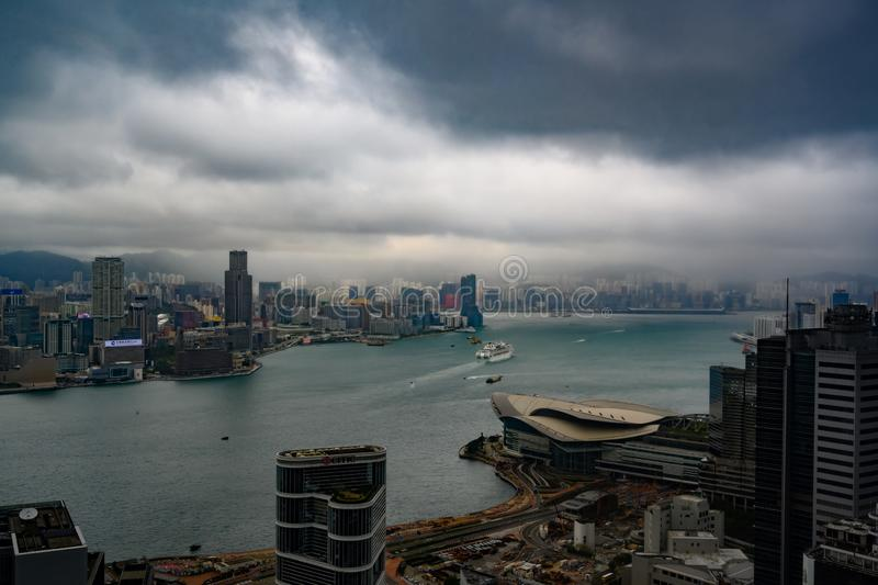 Hong Kong on rainy day with dark rain clouds stock photography