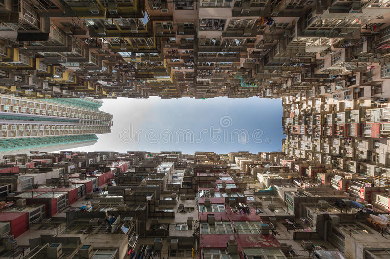 Hong Kong residence apartment from bottom view. With blue sky background royalty free stock photo