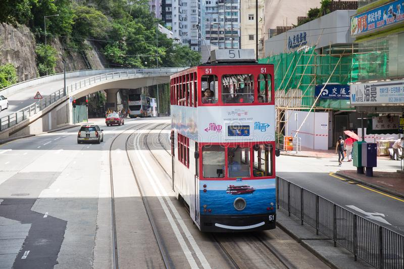 Hong Kong S.A.R. - July 13, 2017: Colorful advertisment on double decker tram or Ding Ding on the street in Causeway Bay Hong. Kong. Hong Kong tram is one of royalty free stock image