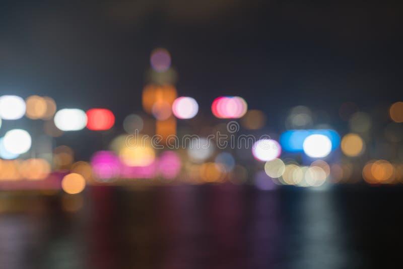 Hong Kong`s Victoria Harbor and commericial Island illuminated i. Abstract high-rise city lights, Hong Kong`s Victoria Harbor and commericial Island illuminated royalty free stock photo