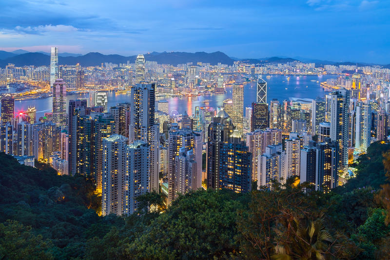 Hong Kong, SAR China - circa July 2015: Skyline of Hong Kong from Victoria Peak at evening royalty free stock photo