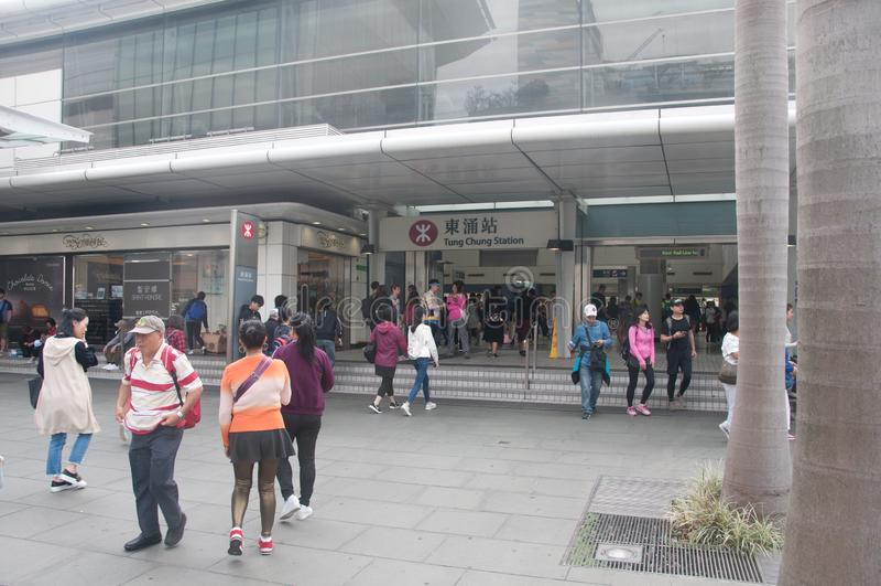 HONG KONG, HONG KONG SAR - NOVEMBER 18, 2018: Tung Chung Subway station with many people walking in and out the entrance stock images