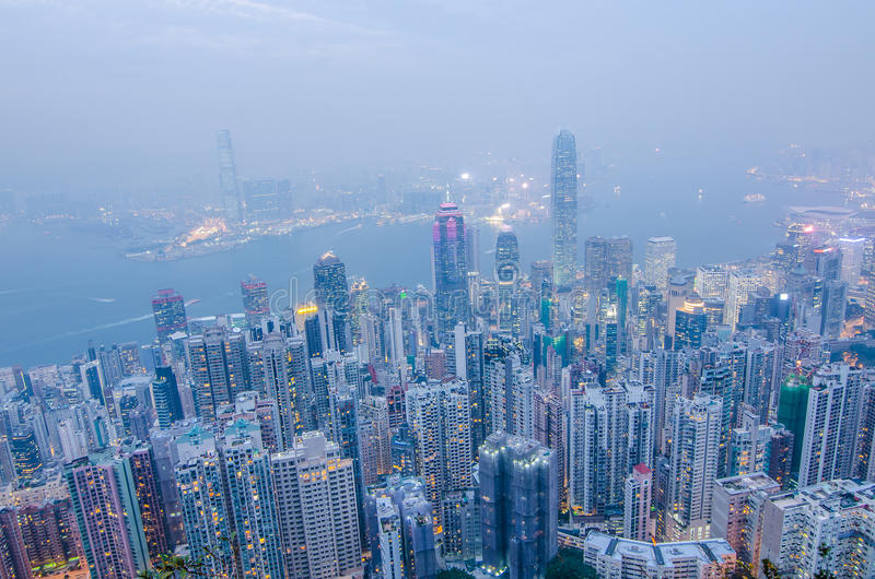 Hong Kong the scenes, victoria harbour from the peak bird view,. In the mist with bad weather in the evening, nimbus landscape on the trails royalty free stock image