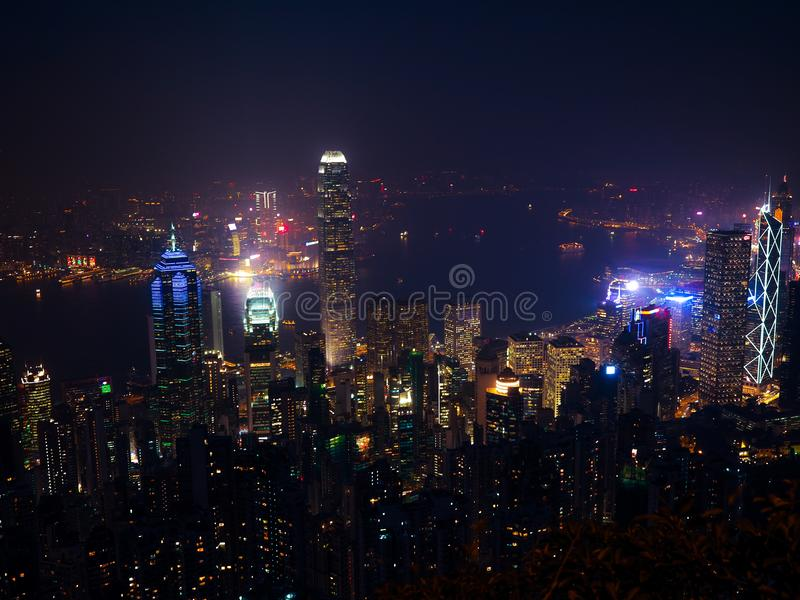 Hong Kong the scenes, victoria harbour from the peak bird view, in the mist with bad weather in the night, nimbus landscape on the. Trails royalty free stock photo